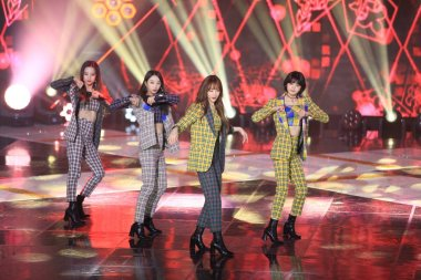 Members of South Korean girl group EXID perform during the South Korean music TV series