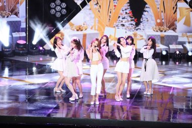 Members of South Korean girl group Gugudan perform during the South Korean music TV series