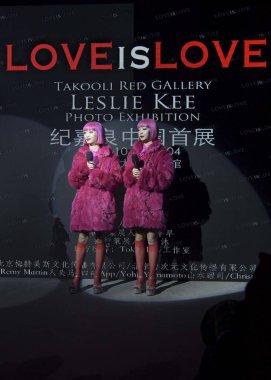 Ami Suzuki and Aya Suzuki of Japanese music duo Amiaya attend the photo exhibition