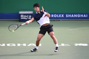 Chung Hyeon of South Korea returns a shot to Hubert Hurkacz of Poland in their second round match of the men's singles during the Rolex Shanghai Masters 2018 tennis tournament in Shanghai, China, 10 October 2018