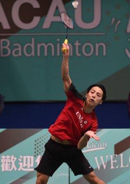 Takuma Ueda of Japan returns a shot to Chi Yu Jen of Chinese Taipei in their qualification match of men's singles during the HSBC BWF World Tour Macau Open Badminton 2018 Tournament in Macau, China, 30 October 2018