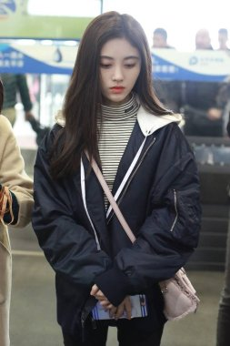 Chinese singer and actress Ju Jingyi arrives at the Beijing Capital International Airport before departure in Beijing, China, 26 November 2018.
