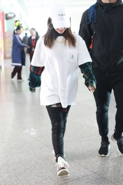 Hong Kong singer Gloria Tang Tsz-kei, better known by her stage name G.E.M., arrives at the Beijing Capital International Airport before departure in Beijing, China, 5 December 2018.