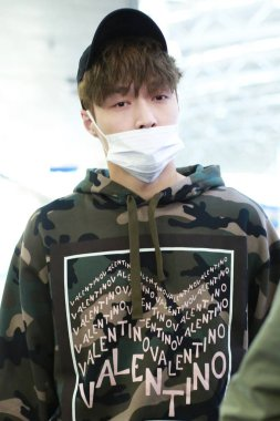 Chinese singer and actor Zhang Yixing, better known as Lay, of South Korean-Chinese boy group EXO, arrives at the Beijing Capital International Airport in Beijing, China, 8 October 2018.