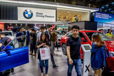 People visit the stand of BMW during the 16th China (Guangzhou) International Automobile Exhibition, also known as Auto Guangzhou 2018, in Guangzhou city, south China's Guangdong province, 16 November 2018