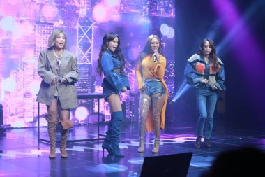 Members of South Korean girl group Mamamoo perform during the showcase to release their eighth mini album