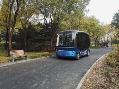 The Apolong, China's first self-driving microcirculation electric minibus jointly developed by Baidu and the Chinese commercial vehicle maker King Long, is pictured in the AI-themed smart park, featuring artificial intelligence (AI) applications from