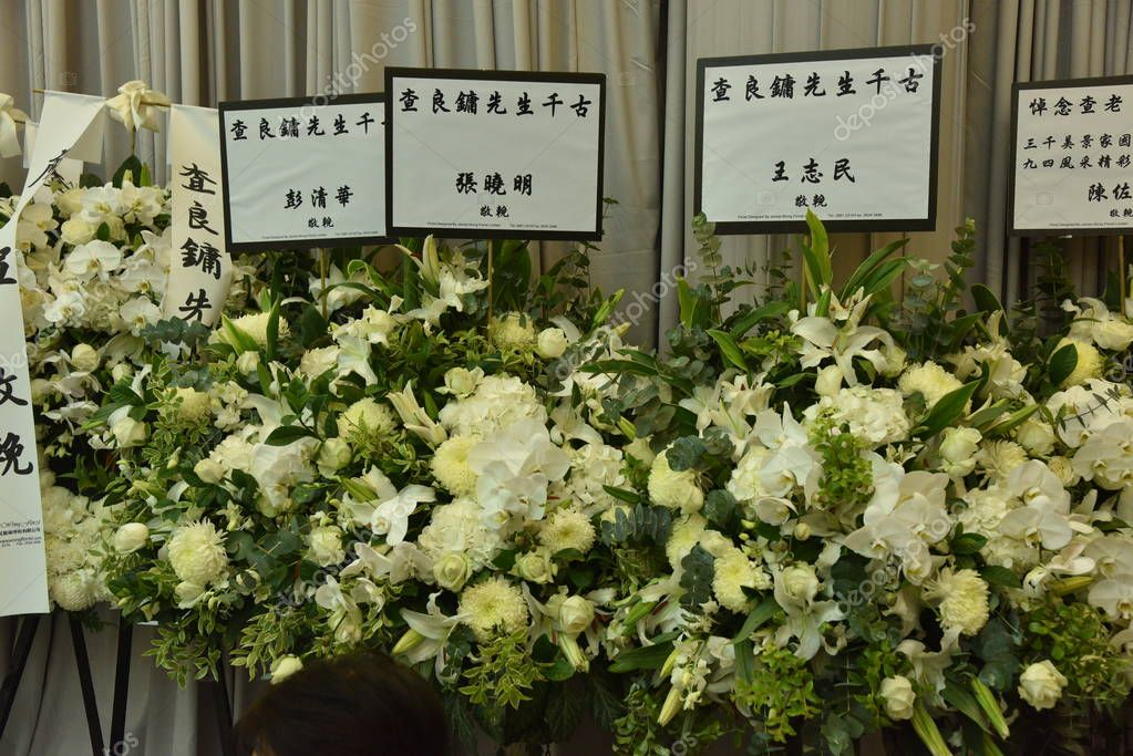 The wreaths prepared by state leaders for famous Chinese martial arts novelist Louis Cha Leung-yung, more widely known by his pen name Jin Yong, are on display at the funeral ceremony in Hong Kong, China, 12 November 2018