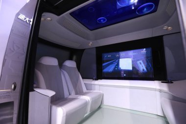 The Apolong, China's first self-driving microcirculation bus jointly developed by Baidu and the Chinese commercial vehicle maker King Long, is on display at the Light of the Internet Expo during the fourth World Internet Conference (WIC), also known
