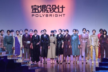 Models display new creations at the fashion show of POLY BRIGHT by Wang Fei during the China Fashion Week Spring/Summer 2019 in Beijing, China, 29 October 2018.