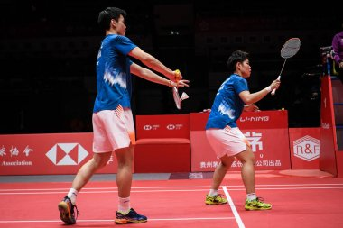 Wang Yilyu and Huang Dongping of China return a shot to Yuta Watanabe and Arisa Higashino of Japan in their Mixed Doubles Group B match during the HSBC BWF World Tour Finals 2018 in Guangzhou city, south China's Guangdong province, 13 December 2018