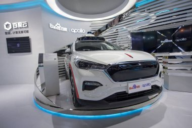 --FILE--View of the stand of Baidu and Apolong, China's first self-driving microcirculation electric minibus jointly developed by Baidu and the Chinese commercial vehicle maker King Long, during an expo in Guangzhou city, south China's Guangdong prov