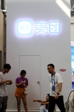 --FILE--People visit the stand of online group buying and food ordering services Meituan during the first Smart China Expo 2018 in Chongqing, China, 23 August 2018