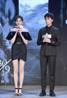 Chinese actress Guan Xiaotong, left, and actor Leo Wu or Wu Lei attend a press conference to promote the movie