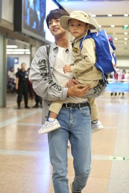 South Korean singer and actor Choi Min-ho, better known as Minho, of South Korean boy group Shinee is pictured at the Beijing Capital International Airport in Beijing, China, 15 September 2018.
