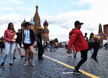 A football fan shows football skills on the Red Square on a rest day during the 2018 FIFA World Cup in Moscow, Russia, 5 July 2018