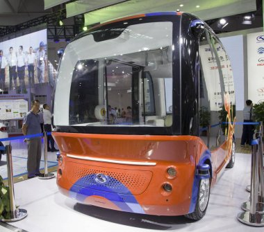 The Apolong, China's first self-driving microcirculation bus jointly developed by Baidu and the Chinese commercial vehicle maker King Long, is on display during an exhibition in Fuzhou city, southeast China's Fujian province, 21 June 2018