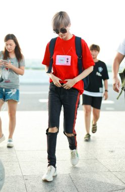 Chinese singer Li Yuchun or Chris Lee is pictured at the Shanghai Hongqiao International Airport before departure in Shanghai, China, 25 July 2018.