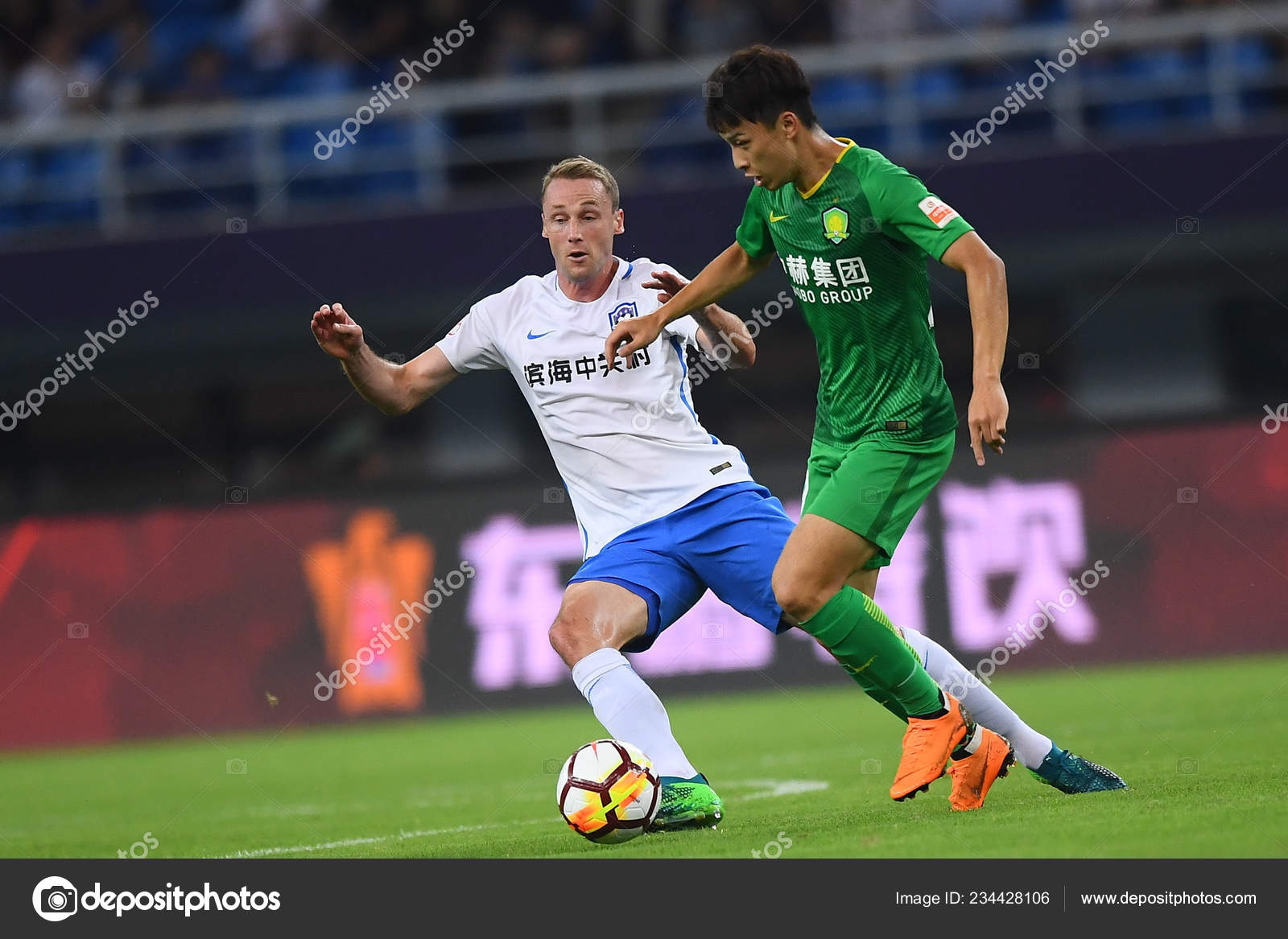 141c88cc7 ... TEDA passes the ball against a player of Beijing Sinobo Guoan in their  20th round match during the 2018 Chinese Football Association Super League  ...