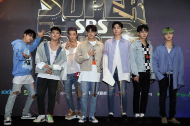 Members of South Korean boy group iKON pose during a press conference for the SBS Super Concert in Taipei, Taiwan, 7 July 2018.
