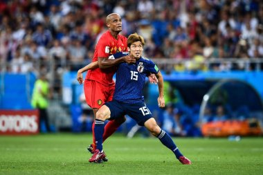 Vincent Kompany of Belgium, left, challenges Yuya Osako of Japan in their Round of 16 match during the 2018 FIFA World Cup in Rostov, Russia, 2 July 2018