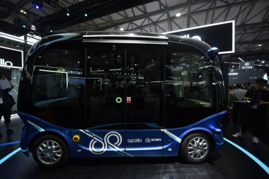 The Apolong, China's first self-driving microcirculation electric minibus jointly developed by Baidu and the Chinese commercial vehicle maker King Long, is on display during the 2018 International Consumer Electronics Show Asia (CES Asia 2018) in Sha