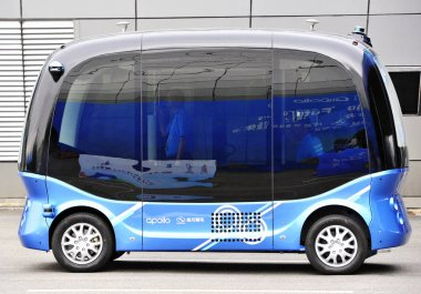 The Apolong, China's first self-driving microcirculation bus jointly developed by Baidu and the Chinese commercial vehicle maker King Long, is pictured in a trial ride during the first Digital China Summit in Fuzhou city, southeast China's Fujian pro
