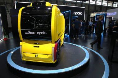 The Apolong, China's first self-driving microcirculation electric minibus jointly developed by Baidu and the Chinese commercial vehicle maker King Long, is on display during the 2018 International Consumer Electronics Show Asia (CES Asia 2018