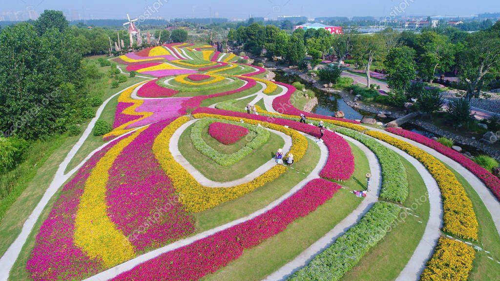 Landscape of terraced fields of flowers in full bloom at the Zhou Ji Green Expo Garden in Nantong city, east China's Jiangsu province, 25 July 2018.