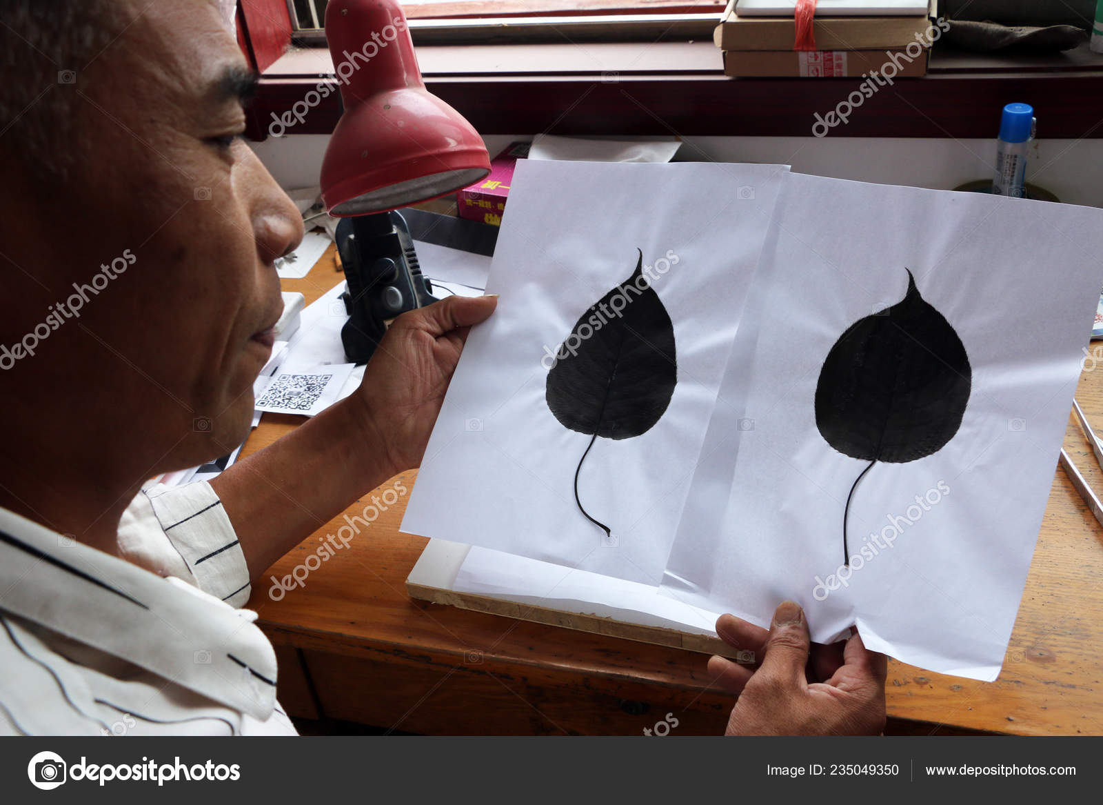 Chinese Craftsman Kong Qingsi Checks Processed Leaves