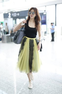 Taiwanese model and actress Lin Chi-ling arrives at the Shanghai Hongqiao International Airport before departure in Shanghai, China, 23 May 2018.