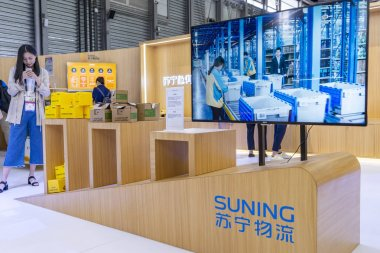 People visit the stand of Suning.com, the online shopping site of home appliance chain Suning during the 2018 International Consumer Electronics Show Asia (CES Asia 2018) in Shanghai, China, 14 June 2017.