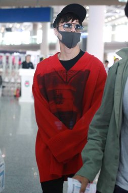 Chinese singer and actor Zhang Yixing, better known as Lay, of South Korean-Chinese boy group EXO, arrives at the Beijing Capital International Airport in Beijing, China, 25 May 2018.