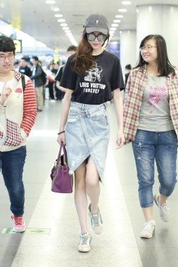 Chinese actress Tiffany Tang or Tang Yan is pictured at the Beijing Capital International Airport in Beijing, China, 24 May 2018.