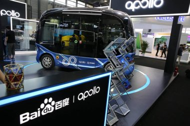 View of the stand of Baidu and Apolong, China's first self-driving microcirculation electric minibus jointly developed by Baidu and the Chinese commercial vehicle maker King Long, during the 2018 International Consumer Electronics Show Asia (