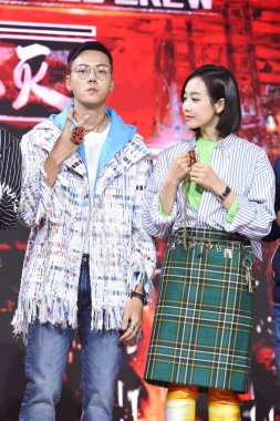 Hong Kong singer and actor William Chan, left, and Chinese singer and actress Victoria Song or Song Qian attend a press conference for the reality talent TV show