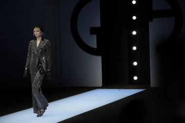 A model displays a new creation at the Giorgio Armani show during the Milan Fashion Week Fall/Winter 2018 in Milan, Italy, 24 February 2018.