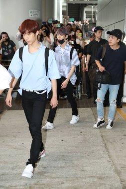 Members of South Korean boy group NCT 127 arrive at the Hong Kong International Airport after landing in Hong Kong, China, 4 August 2017.