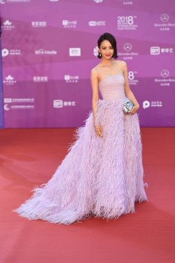 Chinese actress Tong Liya arrives on the red carpet for the closing ceremony of the 8th Beijing International Film Festival in Beijing, China, 22 April 2018