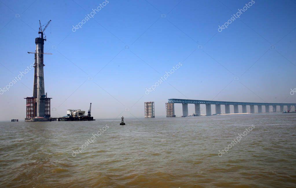Aerial view of the No.28 main pier of the world's longest cable-stayed bridge, the Hutong (Shanghai-Nantong) Yangtze River Bridge, under construction on the Yangtze River in Nantong city, east China's Jiangsu province, 19 April 2018