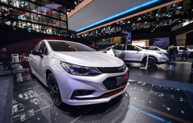 A Chevrolet Cruze Redline and other Chevy cars of General Motors (GM) are on display during a preview of the 15th Beijing International Automotive Exhibition, also known as Auto China 2018, in Beijing, China, 24 April 2018
