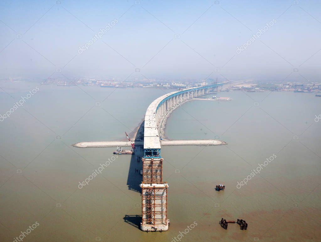 Aerial view of the world's longest cable-stayed bridge, the Hutong (Shanghai-Nantong) Yangtze River Bridge, under construction on the Yangtze River in Nantong city, east China's Jiangsu province, 19 April 2018