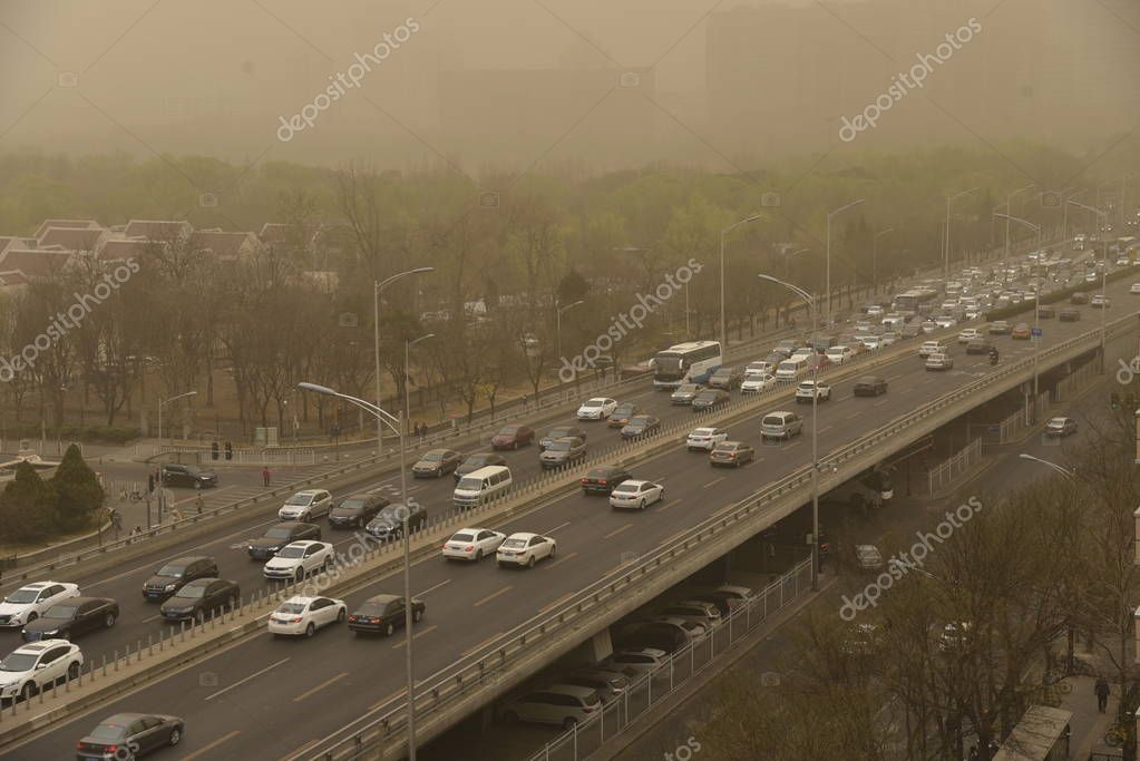 View of traffic amid a sandstorm in Beijing, China, 28 March 2018