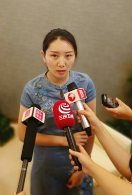 A Chinese woman from Beijing, who is the first vaccine recipient to be inoculated with the monovalent Gardasil 9 human papillomavirus (HPV) vaccine against nine viruses leading to cervical cancer, is interviewed after the vaccination at Boao Super Ho