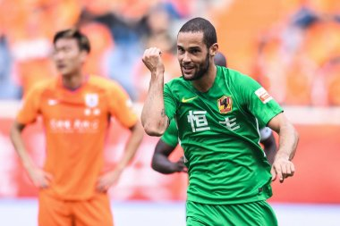Spanish soccer player Mario Suarez of Guizhou Hengfeng celebrates after scoring against Shandong Luneng Taishan in their fourth round match during the 2018 Chinese Football Association Super League (CSL) in Ji'nan city, east China's Shandong province