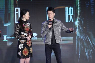 Chinese actress Liu Yifei, left, and Chinese actor Feng Shaofeng attend a press conference for their movie