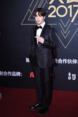 Hong Kong singer and dancer Jackson Wang of South Korean boy group GOT7 poses as he arrives at the red carpet for the 2017 Tencent Video Star Awards in Beijing, China, 3 Decmeber 2017