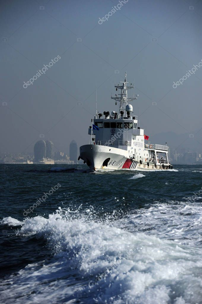 Rescue vessels take part in a drill jointly conducted by the Ministry of Transport's Nanhai Rescue Bureau, Nanhai No 1 Flying Rescue Service and the Hainan Maritime Safety Administration in Sanya city, south China's Hainan province, 19 December 2017