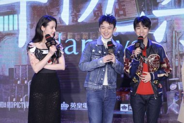 (From left) Chinese Uigur actress Dilraba Dilmurat, actor Dong Zijian, and Karry Wang or Wang Junkai, of Chinese boy group TFBoys attend a premiere event for movie