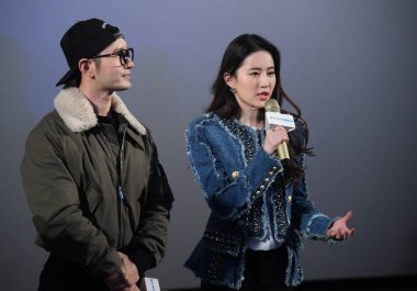 Chinese actress Liu Yifei and Chinese actor Huang Xiaoming attend a promotional event for Liu Yifei's movie